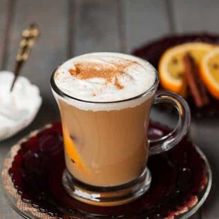 Warm your belly this fall with a Hot Apple Toddy made in your slow cooker with apple cider, clove studded oranges, whiskey, and real whipped cream.