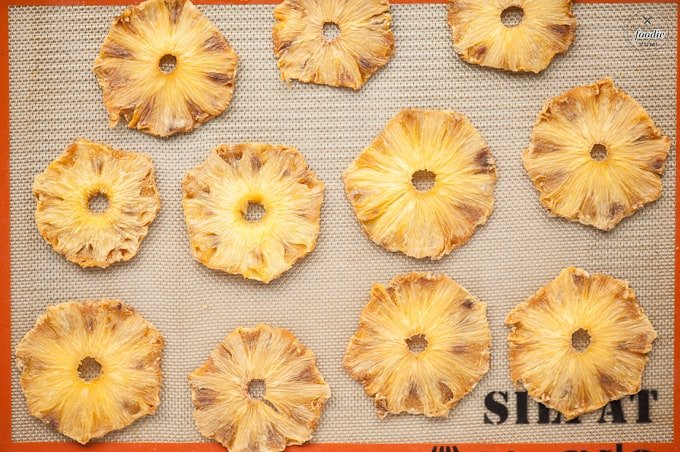 homemade dried pineapple rings on baking sheet