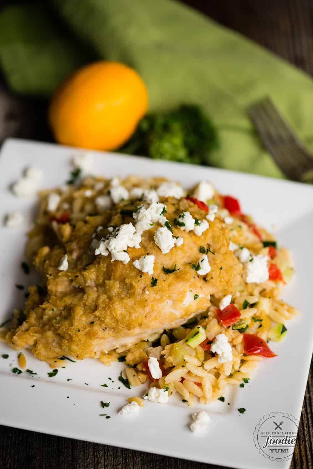 Hummus baked chicken with feta and vegetable orzo