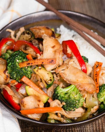 hunan chicken stir fry in bowl over rice