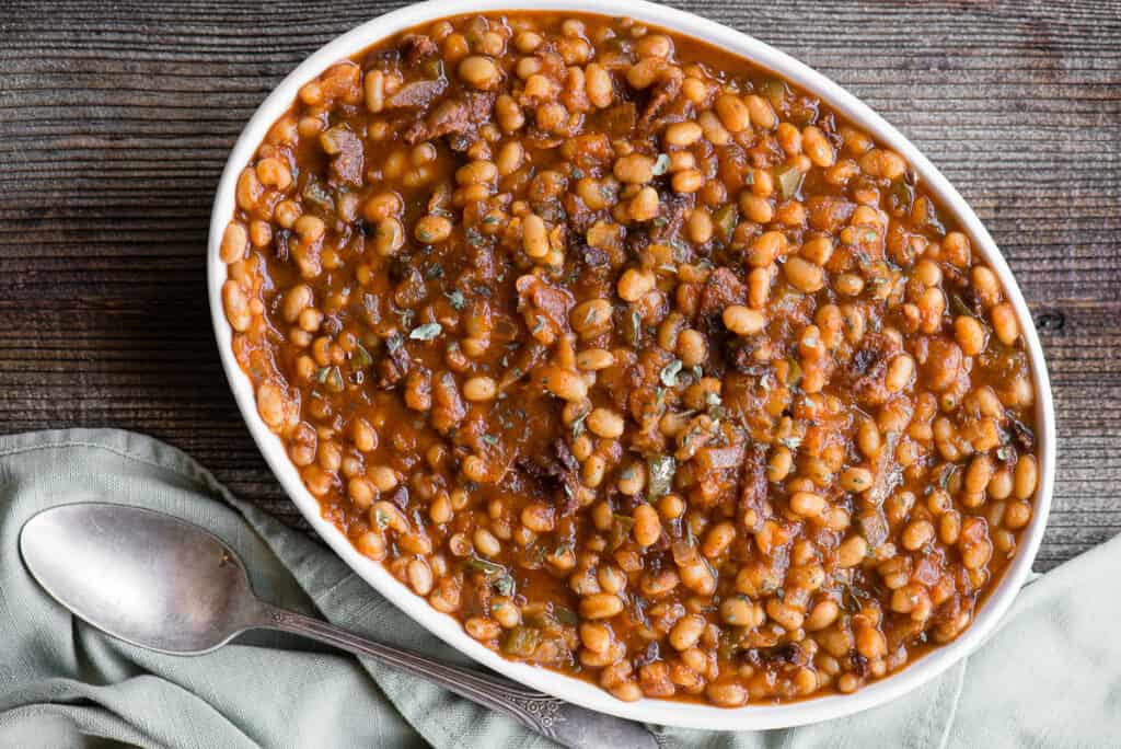 oval dish of bacon baked beans