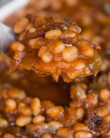 spoonful of homemade baked beans with bacon