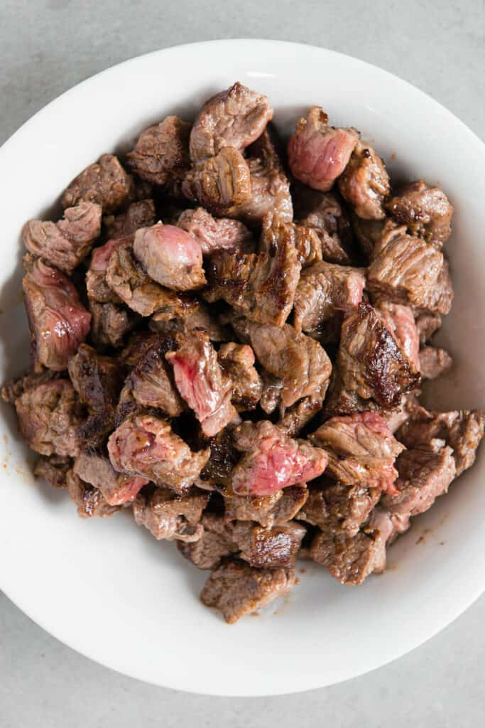 seared pieces of beef stew meat