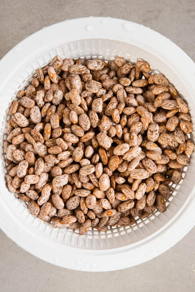 rinsed pinto beans in colander