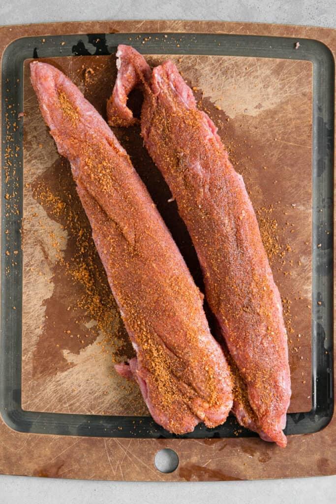 pork tenderloin covered in dry rub