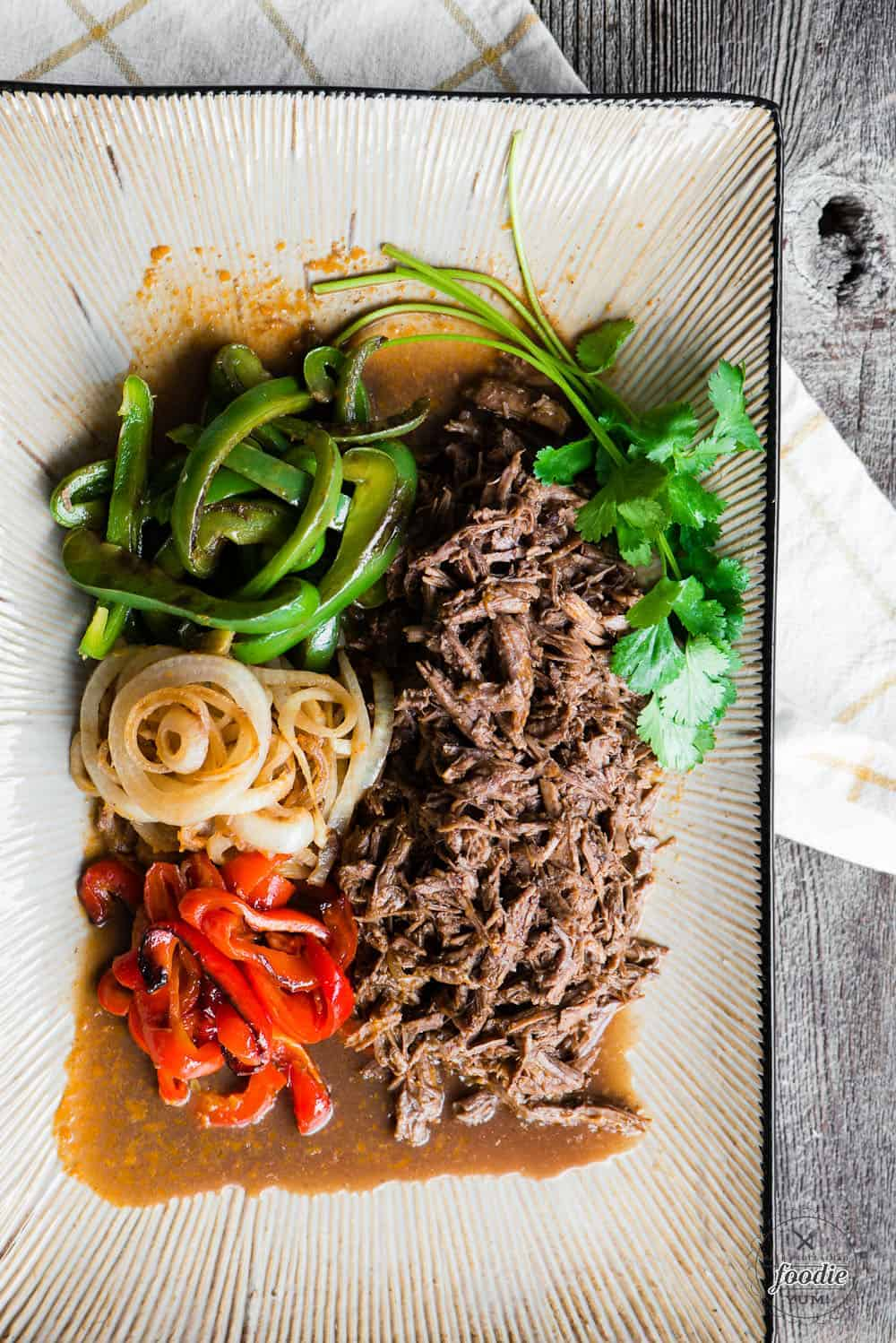 shredded beef with sauce with bell peppers and onions