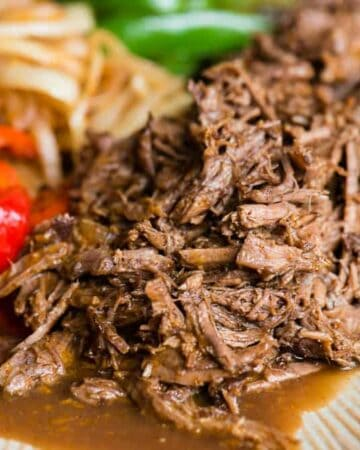 tender shredded beef with peppers and onions made in the instant pot