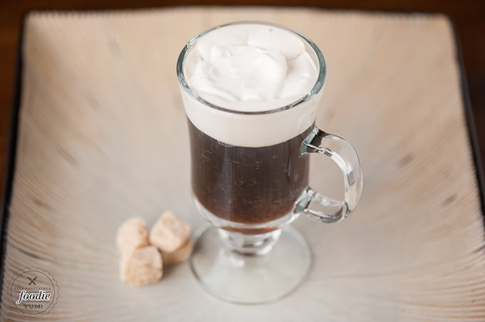 Coffee and whiskey topped with whipped cream and irish cream
