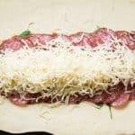 making an Italian stromboli with mozzarella