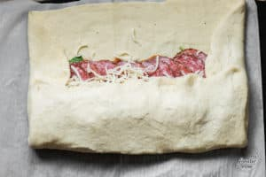 making an Italian stromboli with pizza dough
