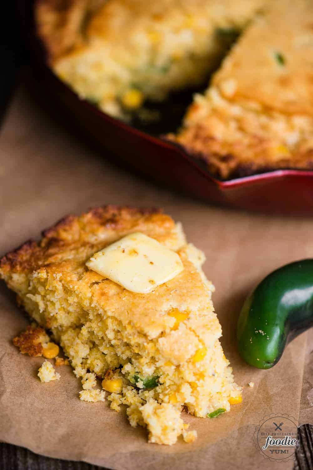 slice of jalapeno cornbread with butter on top
