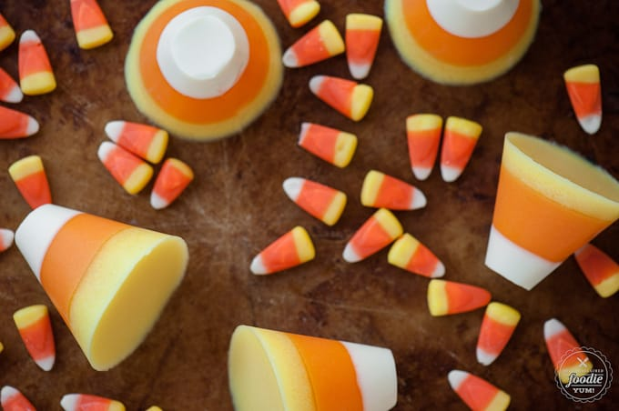 Kid friendly Jiggly Jello Candy Corns are a fun to make Halloween treat that would be a hit at any party. You can also make an adult version with vodka!