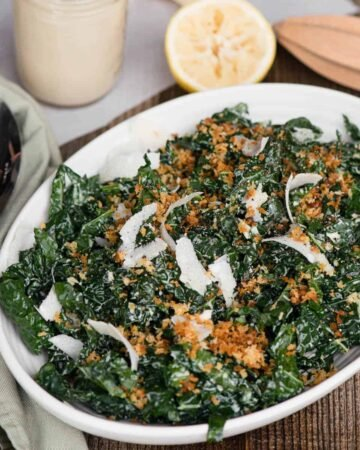 kale ceasar salad in white dish