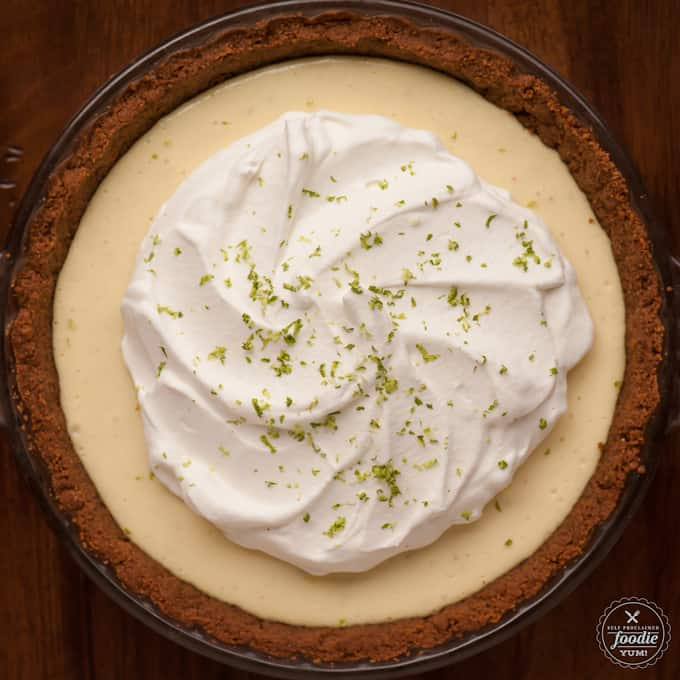 This authentic homemade Key Lime Pie made with a gingersnap crust will deliver the perfect mouthwatering dessert in the form of a slice of heaven.