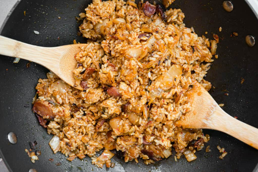 kimchi fried rice with bacon in wok pan