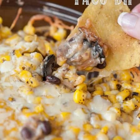 Krissy's Warm 7 Layer Taco Dip has all the delicious ingredients you'll find in your favorite taco and makes a perfect family dinner or game day grub.