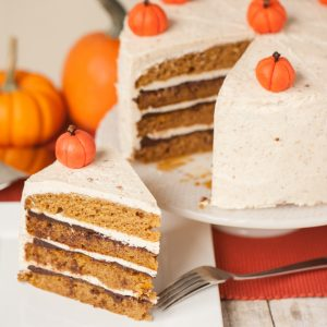 The best delicious fall dessert is this moist homemade Layered Pumpkin Cake with hazelnut buttercream, drunken chocolate ganache, and marzipan pumpkins!