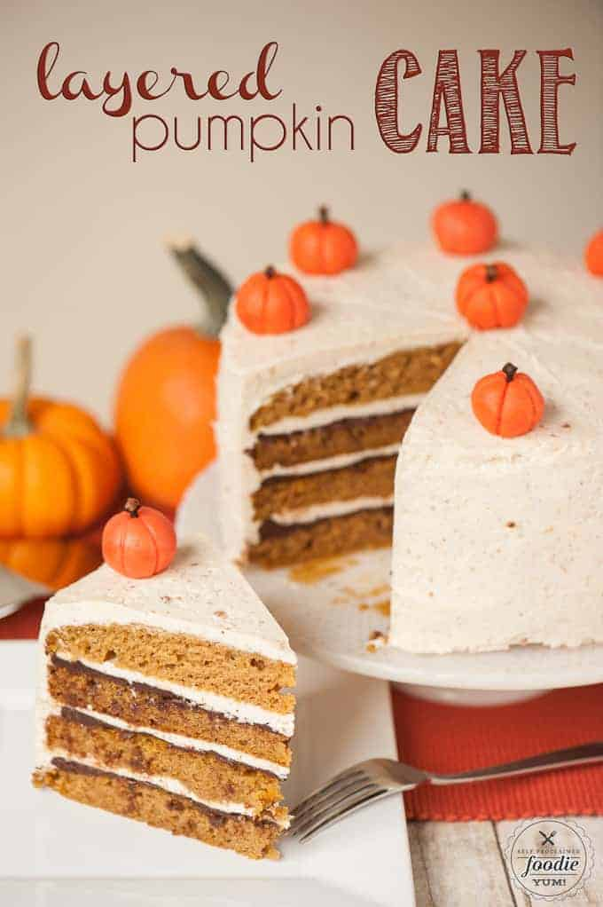 Thefrosted layered pumpkin cake being sliced