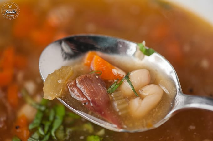 spoonful of slow cooker leftover ham soup with beans