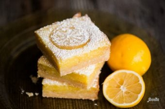 Homemade Lemon Bars, also known as Lemon Squares, are a super sweet and tart bar cookie. The base is a rich and delicious lemon shortbread. The top is a creamy and heavenly lemon custard layer. The ration of lemon to shortbread is perfect. This is the best lemon bar recipe you will find!