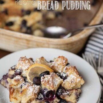 lemon blueberry ricotta bread pudding  on a plate