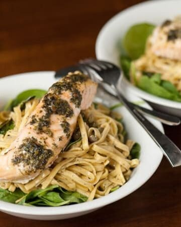 This incredibly easy to make and absolutely delicious Lemon Caper Pesto Salmon Pasta is a gourmet dinner ready in less than 25 minutes!