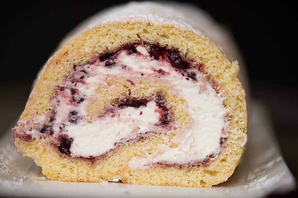 Lemon Lingonberry Jam Cake Roll is a lovely and delicious dessert consisting of scratch made lemon cake, sweet lemon cream, and tart lingonberry preserves.