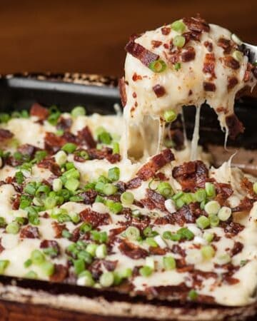 Take your mashed potatoes to the next level by serving this delicious Loaded Cheesy Mashed Potato Casserole as the perfect side dish at your next dinner.