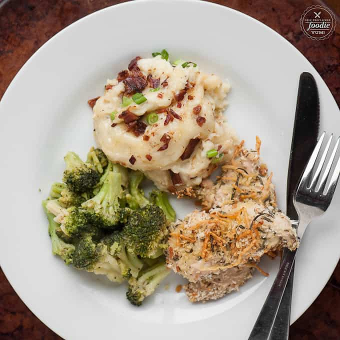 mashed potato casserole with chicken and broccoli on a plate