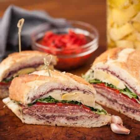 Just imagine how tasty these mouthwatering cured meats, marinated veggies, fresh greens, and melty cheese on this Loaded Grilled Italian Sandwich taste!