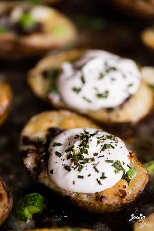 homemade potato skins topped with sour cream