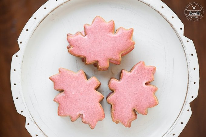 white plate with maple cut out sugar cookies