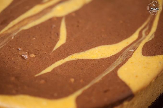 A close up of a chocolate pumpkin cheesecake