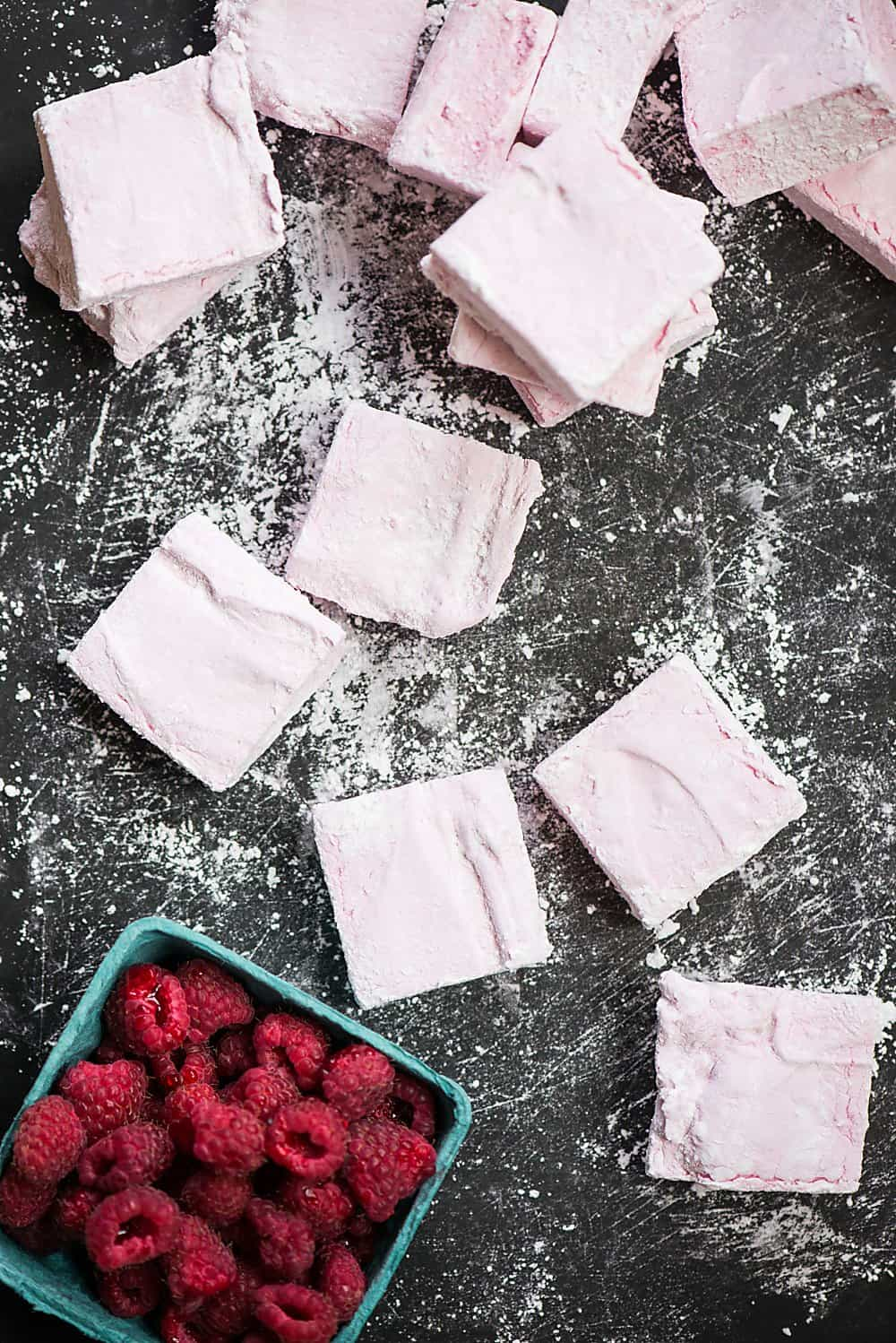 Homemade Raspberry Marshmallows, made with fresh raspberry puree, are surprisingly easy to make and are a fun summer dessert your family will love!