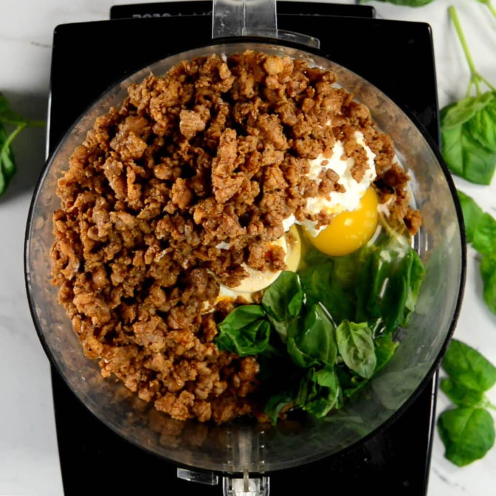 Cooked Italian sausage with egg and ricotta