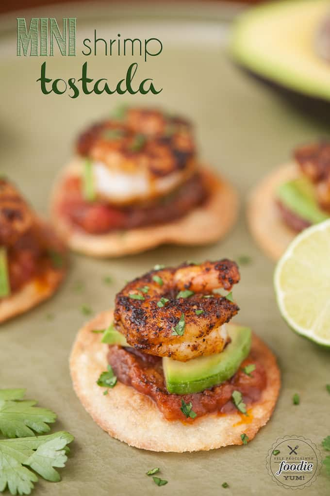 Mini Shrimp Tostadas, made with crisp corn tortilla rounds, beans, salsa, and sauteed jumbo shrimp, are an easy appetizer perfect for parties or game day.