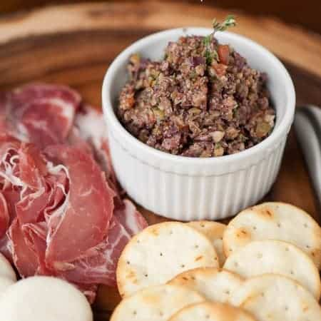 Mixed Olive Tapenade is a quick and easy appetizer that goes perfectly with crusty bread, charcuterie and cheese boards, and a nice bottle of wine.