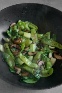 cooked mushrooms, snow peas, bok choy
