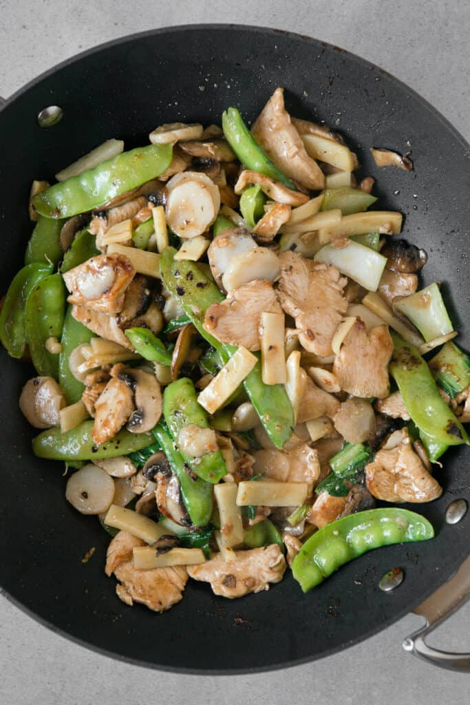 chicken with vegetables in wok pan