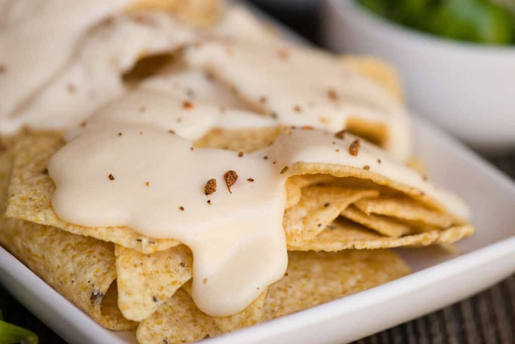 close up of Homemade Nacho Cheese sauce on chips