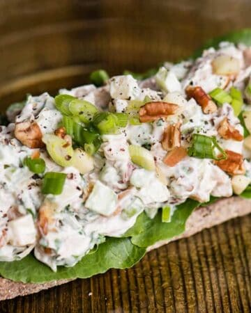 Open-faced Chicken Salad Sandwich makes for a delicious lunch! This Chicken Salad recipe comes together in minutes with cooked chicken, mayo, tart apple, crisp celery, and pecans for that extra crunch. Served open-faced on a single piece of bread gives you the same satisfaction of a sandwich with fewer carbs!