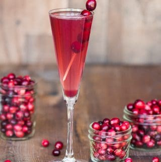 Orange Cranberry Prosecco is an easy single serving winter cocktail made from sweetened tart cranberry juice, orange liqueur, and Riondo Prosecco.
