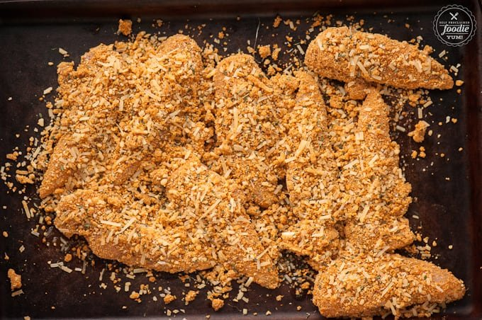 chicken tenders with crispy coating ready to be baked