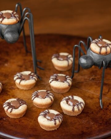 Kids love these Peanut Butter Spider Cookies because they are super fun and easy to make, taste great, and are the perfect Halloween treat.