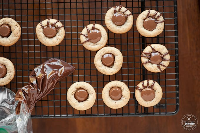 Kids love these Peanut Butter Spider Cookies because are super fun and easy to make, taste great, and are the perfect Halloween treat.
