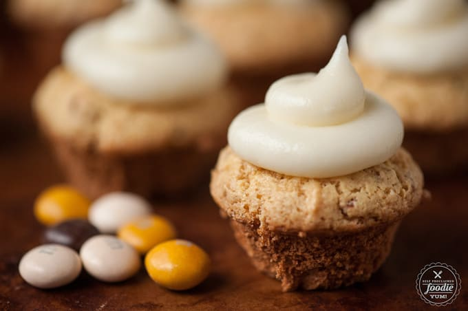 These delicious and easy to make Pecan Pie Fun Cakes topped with cream cheese frosting and M&M's® Pecan Pie pieces are the perfect Fall dessert.