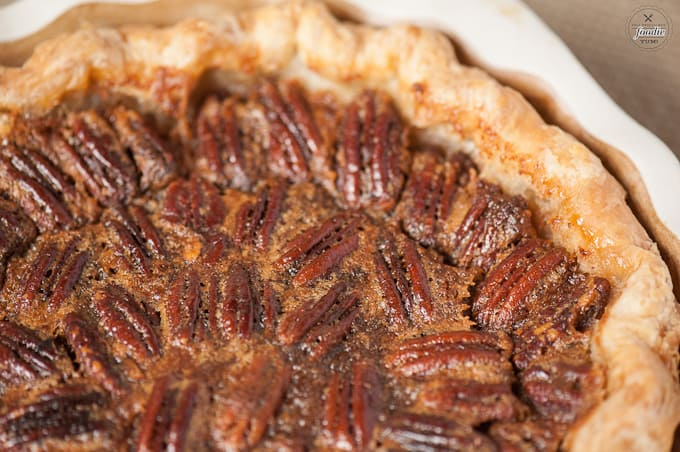 A close up of pumpkin pecan pie