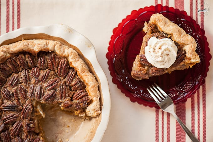 A plate of food with a slice of pecan pie