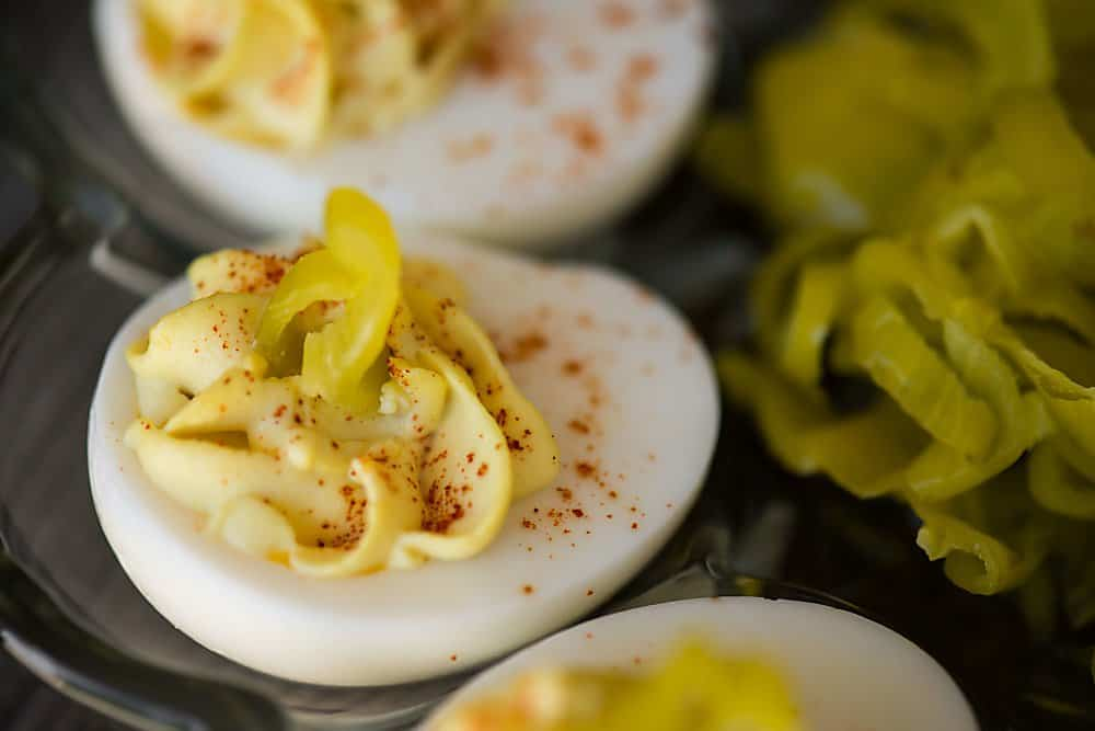 deviled egg with pepperoncini on top