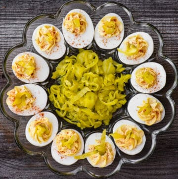 tray of deviled eggs with pepperoncinis